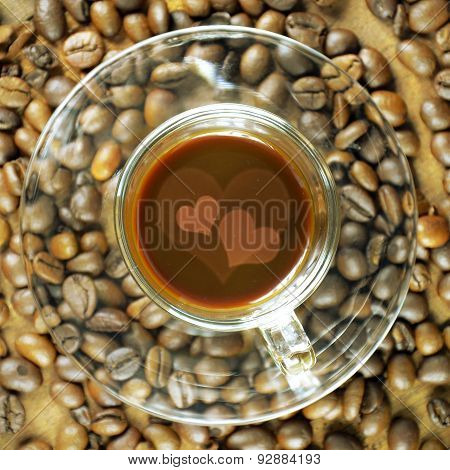 Cup Of Coffee Backgrounds With Coffee Beans On Wood.
