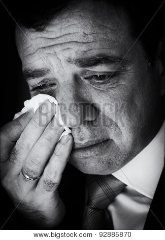 Crying businessman. Black and white portrait