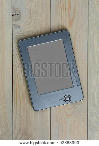 E-book on a wooden background