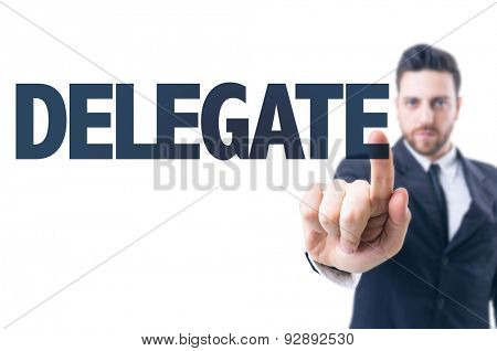 Business man pointing the text: Delegate