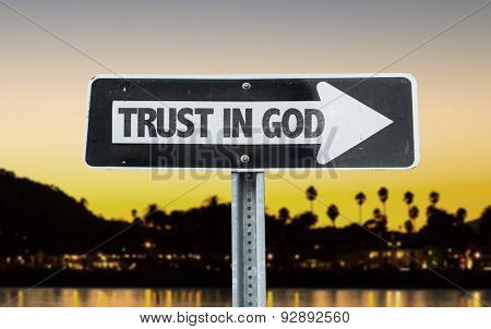 Trust in God direction sign with sunset background