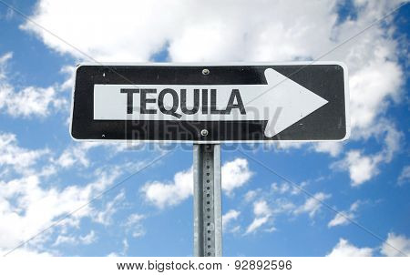 Tequila direction sign with sky background