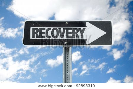 Recovery direction sign with sky background