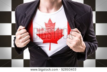 Businessman stretching suit with Canada Flag on checkered background