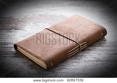 Hand Made Leather Notebook Over Wooden Vintage Background