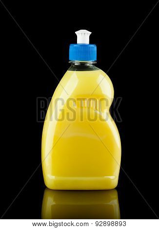 Yellow Plastic Bottle Over Black