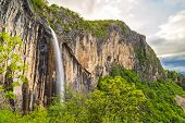 stock photo of waterfalls  - Skaklya is the highest waterfall on Balkan Peninsula - 141 meters. Skaklya is intermittent flowing waterfall - only during snow melt in spring and rains. Located nearly the town of Vratsa Bulgaria. ** Note: Soft Focus at 100%, best at smaller sizes - JPG