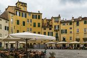 stock photo of piazza  - Former a Roman anphitheater now Piazza Anfiteatro is one of the most famous place in Lucca Italy - JPG