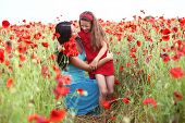 pic of 7-year-old  - Mother and her 7 years old preteen child playing in spring flower field - JPG