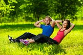 Couple exercising at the city park. Outdoor sport poster