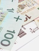 picture of receipt  - Closeup of banknotes lying on receipt finance concept - JPG
