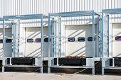 image of loading dock  - row of white loading dock under construction - JPG
