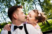 picture of flirt  - Young romantic couple flirting in summer park - JPG
