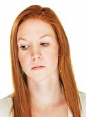 image of sulky  - Close up of isolated disappointed Caucasian female - JPG