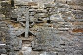 stock photo of fortified wall  - Cross on the wall of the Izborsk fortress - JPG