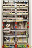 picture of breaker  - Control panel with many circuit breakers in fusebox - JPG