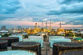 foto of greenpeace  - Oil refinery and storage tanks at twilight - JPG