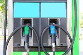 picture of petrol  - Green and blue Fuel nozzle at the Petrol station - JPG