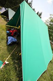 pic of boy scout  - huge tent of boy scout camp with backpacks and sleeping bags spread out - JPG