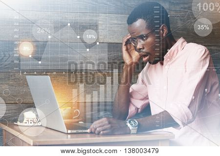 Double Exposure Of African American Entrepreneur Looking At Laptop Screen With Surprised Expression,