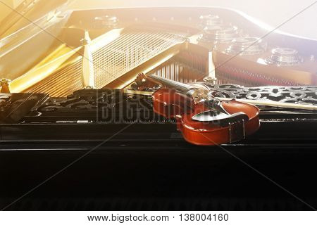 Violin lying on piano, close up