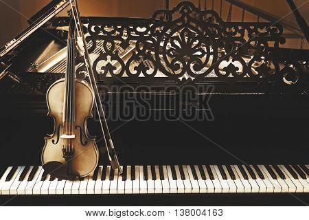 Violin on piano keys, close up