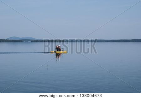 Rest on a catamaran on the summer lake