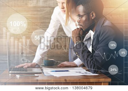 Teamwork And Cooperation: African Man In Formal Suit And Caucasian Woman In White Shirt Videoconfere