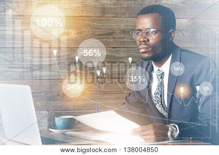 Double Exposure Of African Student In Suit And Glasses Sitting In Front Of Laptop With Dreamy Pensiv
