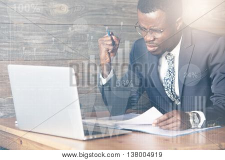 Visual Effects. Angry African Businessman Displeased With Computer Hung While Working In The Office