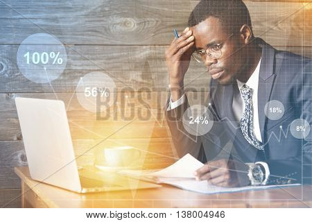 Double Exposure Of Worried African Employee Using Laptop, Looking At The Screen With Frustrated Expr