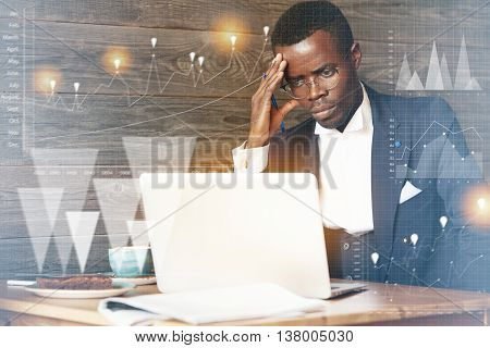 Visual Effects. Double Exposure Of Tired African Businessman In Glasses Using Laptop Computer With C