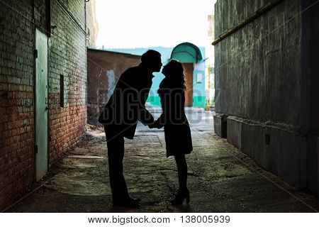 Couple shadow is kissing in dark tunnel