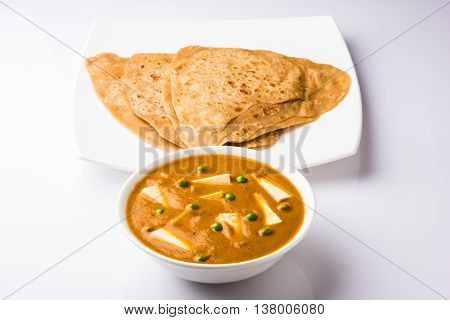 paneer butter masala served with roti / chapati and green salad