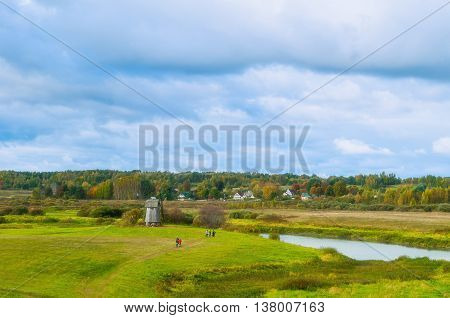 Autumn colorful landscape with autumn view of Soroti river valley in Pushkinskiye Gory Russia - autumn cloudy landscape of autumn nature in cloudy autumn weather. Soft focus processing