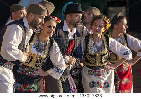 ROMANIA TIMISOARA - JULY 7 2016: Young Serbian dancers in traditional costume perform folk dance during