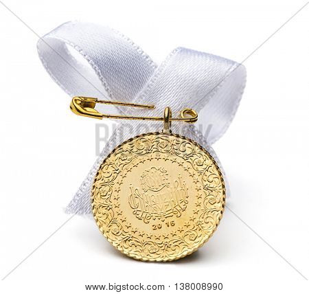 Half Turkish gold coin, front view with white ribbon isolated on white background.