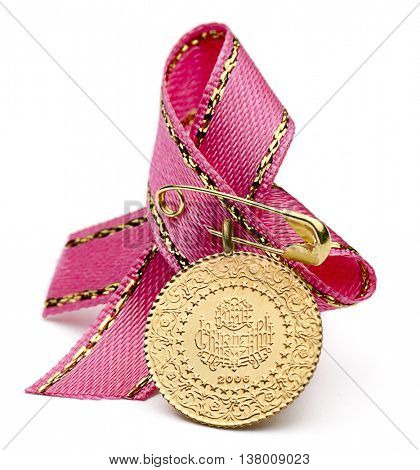 1/4 Turkish gold coin with pink ribbon isolated on white background.