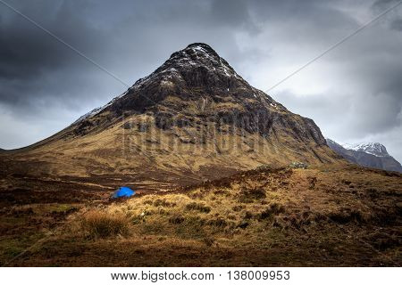 Blue tent camping in Glencoe Scotland UK.