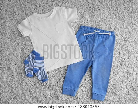 Child clothes on light background