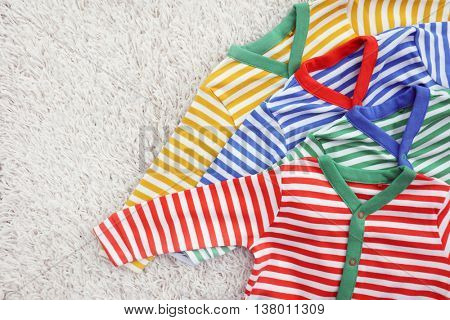Baby clothes on light background