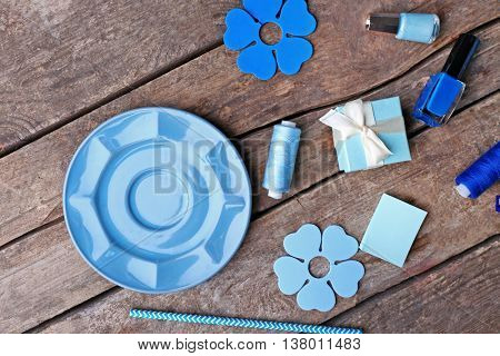Blue colour flat lay composition on wooden background, top view