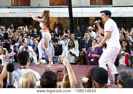 NEW YORK-JULY 11: Lin-Manuel Miranda (R) and Jennifer Lopez perform onstage at NBC's Today Show at Rockefeller Plaza on July 11, 2016 in New York City.