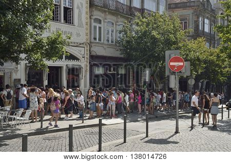 PORTO, PORTUGAL - AUGUST 10, 2016: Queue to get into the famous bookstore Lello in Porto Portugal