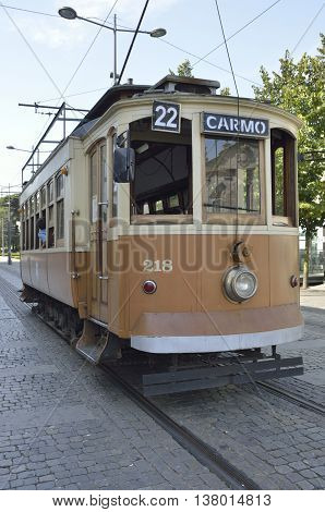 PORTO, PORTUGAL - AUGUST 10, 2016: Line 22 Tram that takes a tourist tour between the districts of Carmo and Batalha in Porto Portugal.