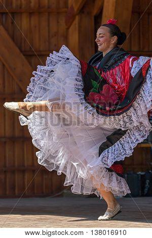 ROMANIA TIMISOARA - JULY 10 2016: Columbian dancer in traditional costume perform folk dance during
