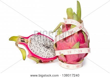Dragon fruit with a tape measure isolated on white background
