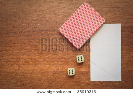 cards and two dice on a wooden table concept