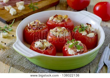 Baked Stuffed Tomatoes With Bacon And Feta Cheese On Rustic Table