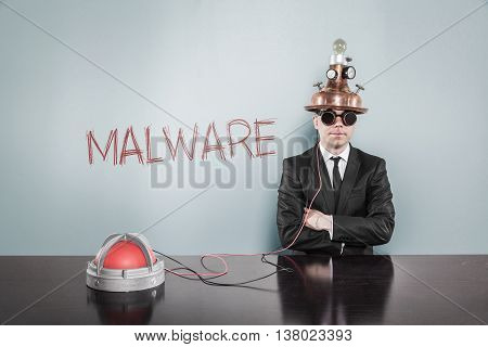 Malware concept with vintage businessman and alert light